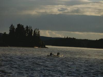 Canoeists Brave Wind-Swept Waters on a Superior National Forest Lake by George F. Mobley