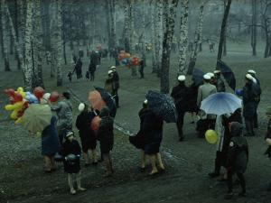 People Strolling Through a Park During a Wet May Snowstorm by George F. Mobley