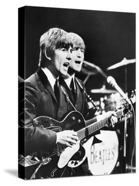 George Harrison (Left) and John Lennon of the Beatles