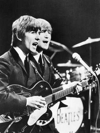 George Harrison (Left) and John Lennon of the Beatles