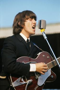 George Harrison Playing Guitar and Singing