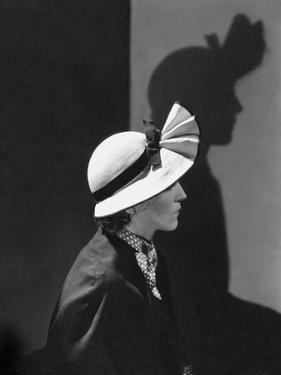 Vogue - December 1934 - Model in a Hat by J. Suzanne Talbot by George Hoyningen-Huené