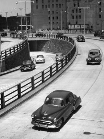 1940's Autos on Urban Highway by George Marks