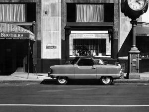 A Nash Car Parked in Front of Store, NYC by George Marks