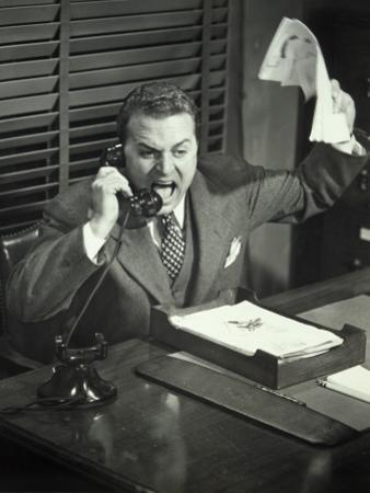 Angry Businessman Inside Office by George Marks
