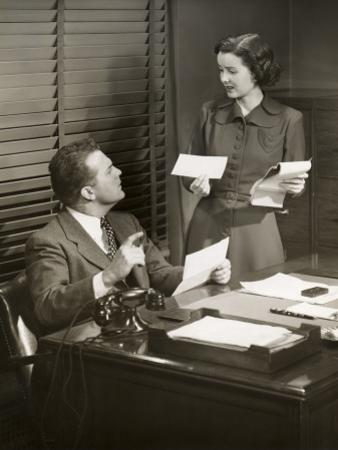 Boss and Secretary Talking by George Marks