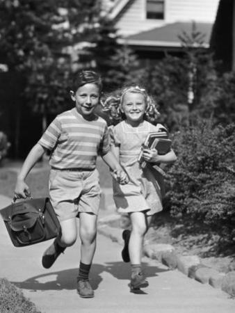 Boy and Girl Running With Books by George Marks