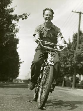 Boy on Bike by George Marks