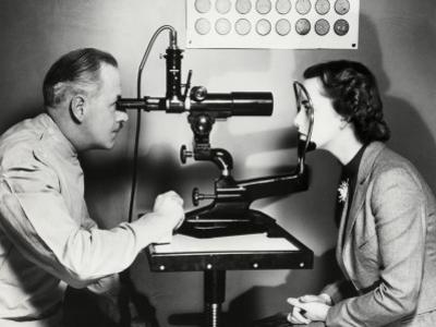 Eye Doctor Examining Patient by George Marks