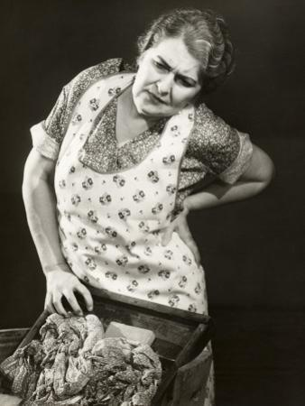 Harried Housewife Doing Laundry by George Marks
