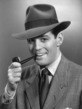 Man Smoking Pipe Wearing Fedora by George Marks