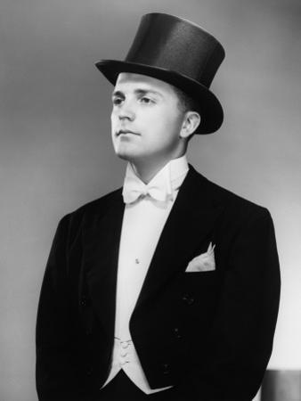 Man Wearing Tuxedo and Top Hat Posing in Studio by George Marks