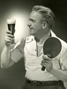 Man With Glass of Beer and Ping-Pong Paddle by George Marks