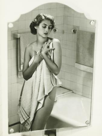 Mirror With Reflection of Woman Covering Herself With Towel in Bathroom by George Marks