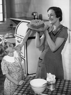 Mother and Daughter Baking Cake by George Marks