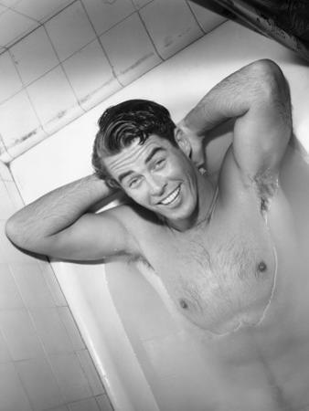 Naked Man Lying in Bathtub by George Marks