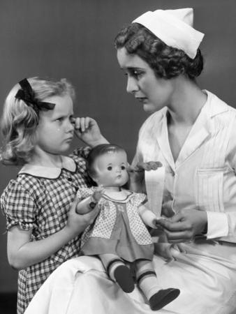 Nurse Consoling Young Girl and Her Doll by George Marks