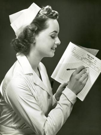 Nurse With Patient's Medical Chart by George Marks
