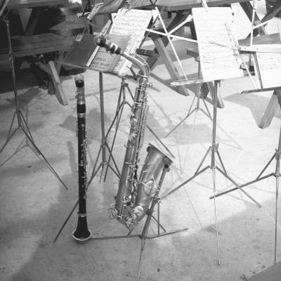 Oboe and Saxophone With Music Sheets by George Marks