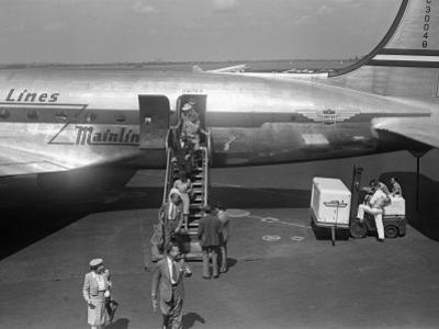 Passengers Disembarking Plane by George Marks