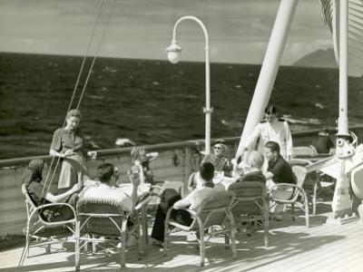 People Having Drinks on Deck of Cruise Ship by George Marks