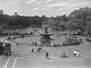 People Walking Around Bethesda Fountain in Central Park, New York by George Marks
