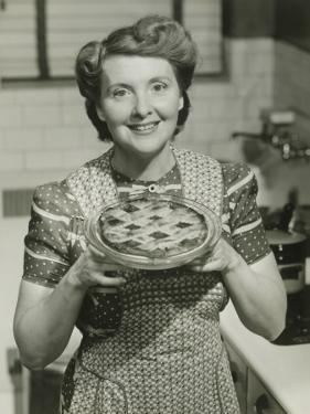 Portrait of Mature Woman Holding Pie by George Marks