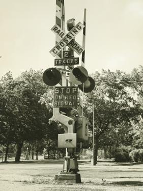 Railroad Crossing Sign and Warning Light by George Marks