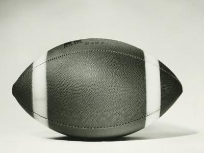 Rugby Ball Against White Background, Close-Up by George Marks