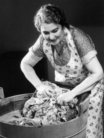 Smiling Housewife Doing Laundry by George Marks