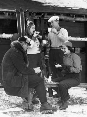 Two Couples in Front of Ski Lodge by George Marks