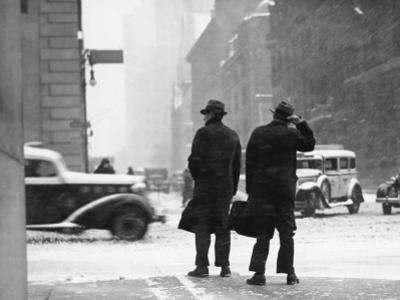 Two Men Walking on City Street in Snow-Storm by George Marks
