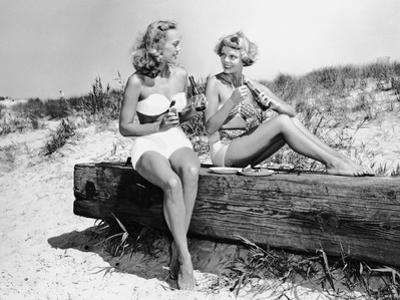 Two Women Drinking Soda on Beach by George Marks