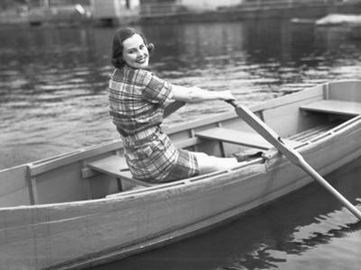 Woman Rowing Boat on Lake by George Marks