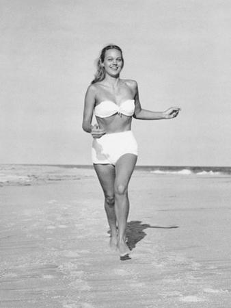 Woman Running on Beach by George Marks
