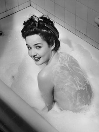 Woman Taking Bubble Bath, (B&W), Elevated View by George Marks