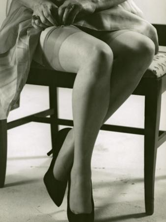 Woman With Silk Stockings Fixes Garter by George Marks