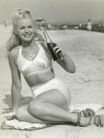 Young Woman Sitting on Beach With Soft Drink, Portrait by George Marks