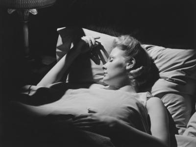 Young Woman Sleeping in Bed (B&W) by George Marks