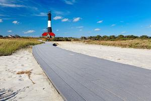 Boardwalk and Lighthouse, Fire Island, New York by George Oze