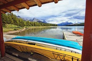 Boats on a Dock, Maligne Lake, Canada by George Oze