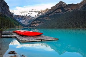 Canoes of Lake Louise, Alberta, Canada by George Oze
