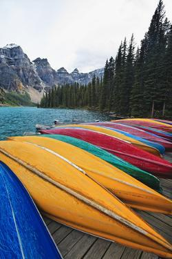 Canoes on a Dock, Moraine Lake, Canada by George Oze