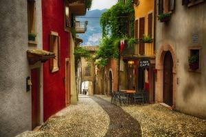 Colorful Street in Malcesine, Lombardy, Italy by George Oze