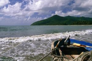 Fishing Boat on Maunabo Beach, Puerto Rico by George Oze