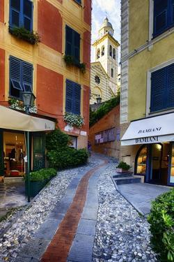Narrow Street Leading Up To A Church In Portofino by George Oze