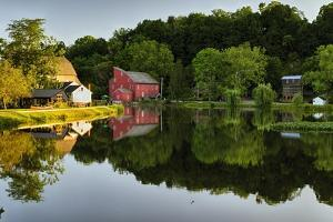 Tranquil River Reflections, Clinton, New Jersey by George Oze