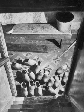 Wooden Shoes in a Hallway at the Bottom of the Stairs by George Rodger