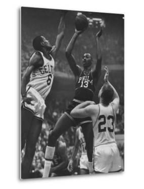 Basketball Players Bill Russell and Wilt Chamberlain During Game by George Silk
