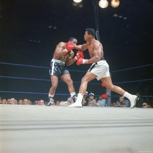 "Cassius Clay, aka Muhammad Ali Throwing Famous ""Phantom Punch"" by George Silk"